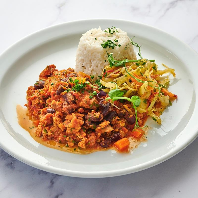 Chilli Sin Carne (made with Legumeat®), rice, salad & spicy slaw
