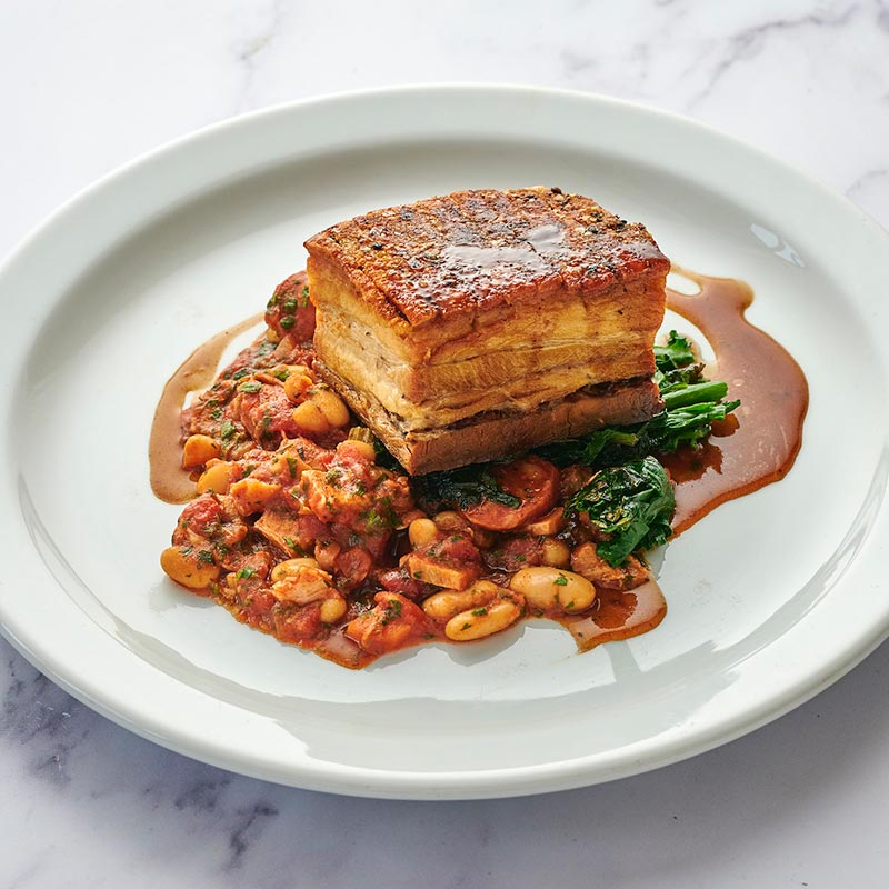 Slowly roasted belly of pork, chorizo & bean cassoulet, braised greens